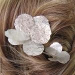 Pics cheveux pétales argentés