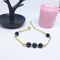 Bracelet: Doré et noir