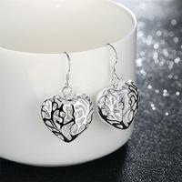Boucles d'oreilles pendantes coeurs