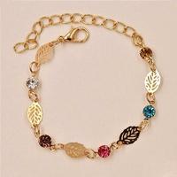 Bracelet Nature Feuilles métal Gold Color serti de Strass colorés