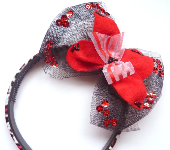 serre tete fleur rouge noir 2