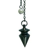 Pendule Triangle patiné en laiton noirci