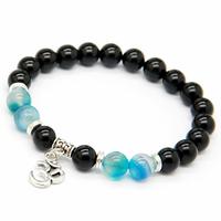 """Bracelet Om """"Stabilité et Persévérance"""" en Onyx et Agate bleue boules 8mm"""