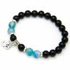 Bracelet-Om-Stabilité-et-Persévérance-en-Onyx-et-Agate-bleue-boules-8mm-1