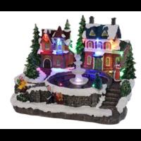 Village de Noël avec fontaine à eau