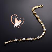 Bracelet plaqué or et zircon et anneaux creux - au coeur des arts