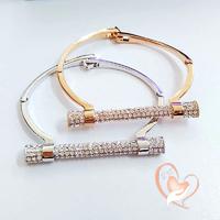Bracelet style Hermes plaqué or rose et cristal - au coeur des arts