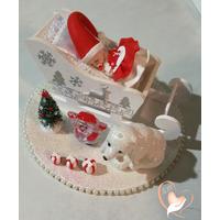 Bébé Noël fille dans son traineau - au coeur des arts