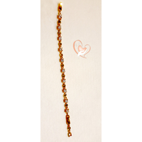 Bracelet  plaqué or orné de pierres cristal griffé  - au coeur des arts