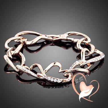 95B-au coeur des arts -bracelet coeur entrelacés plaqué or rose et cristal