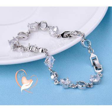 104- au coeur des arts - Bracelet plaqué argent zirconet anneaux ovales creux