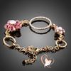 Bracelet plaqué or fleurs roses et anneaux cristal swarovski - au coeur des arts