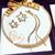 72-au coeur des arts-boubles oreille-etoiles-plaque-or