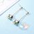74-au coeur des arts-boucles d'oreille cube cristal plaque or longue