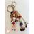 Porte clés ou bijou de sac poupée blanche et rouge - au coeur des arts