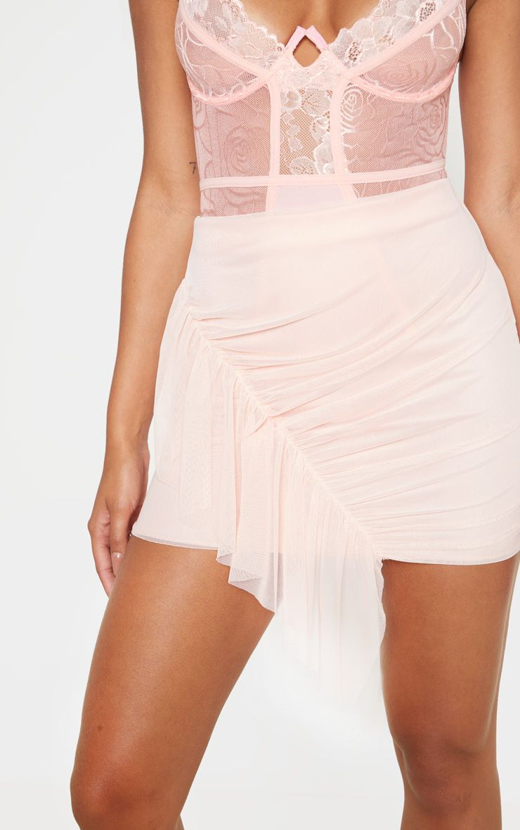 Mini-jupe en mesh à volants - Rose