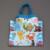 3926-serviette-de-table-enfants-cou-elastique-animaux-et-sa-pochette-assortie-lilooka