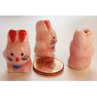 Perles Porcelaine LAPIN LIEVRE rose 21mm par 2 pcs