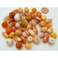Mix Perles verre lampwork tons oranges par 75 grammes