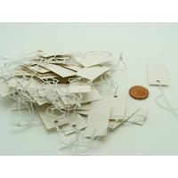 Etiquettes carton 33x17mm blanc avec fil élastique par 50 pcs