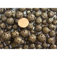 Perles Métal Bronze Rondes Cage MIX par 200 grammes