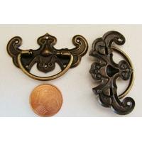 Poignée 44x28mm métal couleur bronze par 1 pc