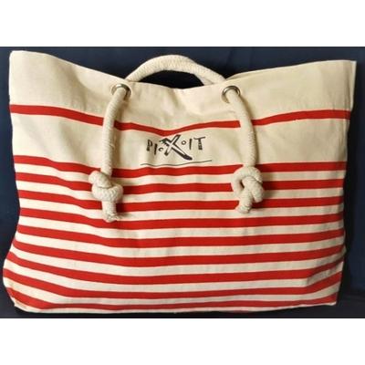 Grand sac de plage rouge  style marin en coton canvas. Anses en cordelettes de coton, poche intérieure zippée, fermeture avec bouton pression