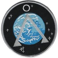 Ecusson symbole terre de l'equipe SG1 vu dans Stargate dans les premières saisons