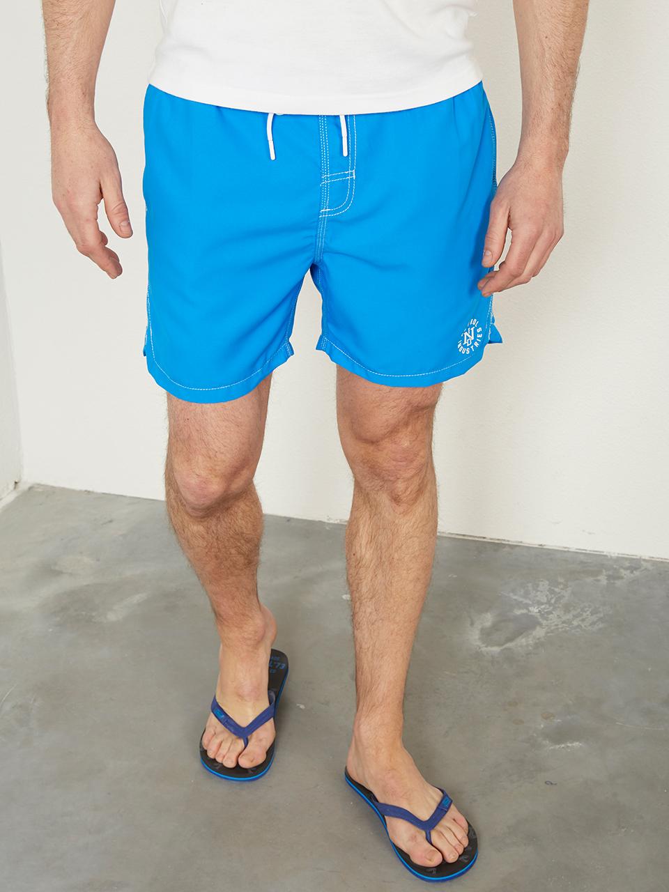 Short de bain uni logo sur le coté bleu éléctrique