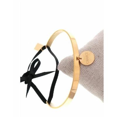 Bracelet jonc pampille chance nœud noir acier inoxydable doré - Mile Mila