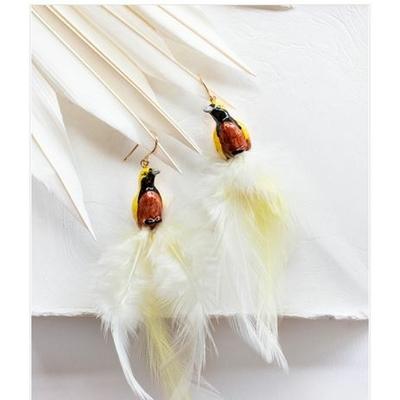 Boucles d'oreilles Oiseau Jaune & Blanc avec plumes - ÉPICÉE NACH