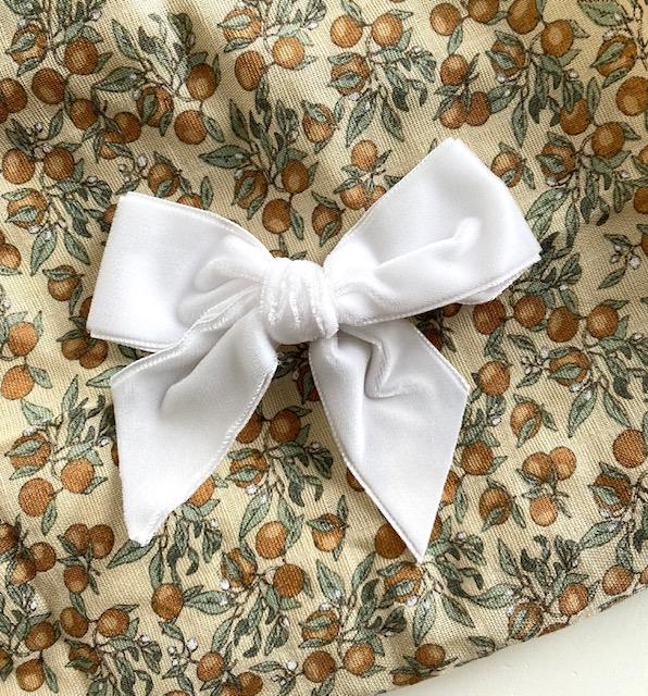 Barrette noeud en velours coloris blanc
