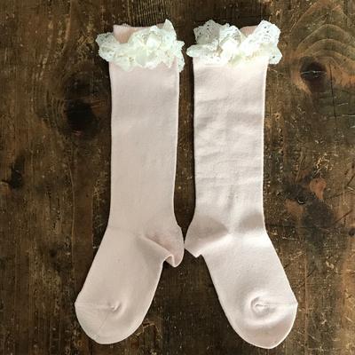 Chaussettes hautes dentelle et noeud coloris Nude