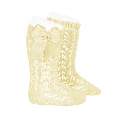 Chaussettes hautes ajourées avec nœud coloris beurre