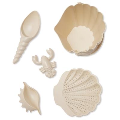 Jouets de plage coloris beige