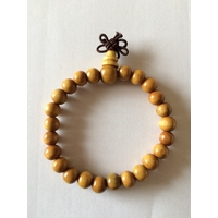 Bracelet porte bonheur : Mala en bois de santal clair