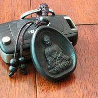 Amulette porte-clefs : Bouddha Amitabha en ébène