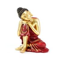 Bouddha penseur rouge et doré
