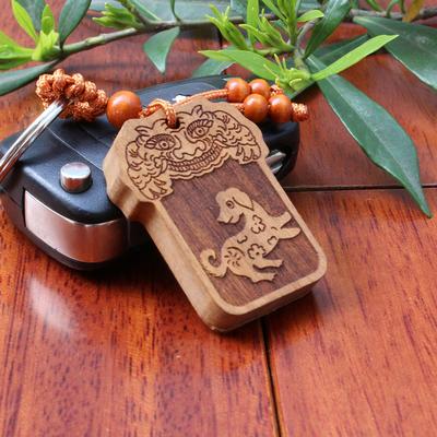 1.Amulette Chien Chinois en bois de pecher