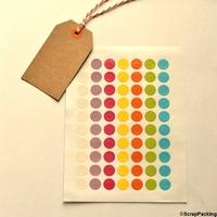 """""""Arc-en-ciel"""" - Planche de 70 oeillets couleur"""