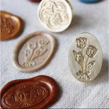 sceau ovale fleur