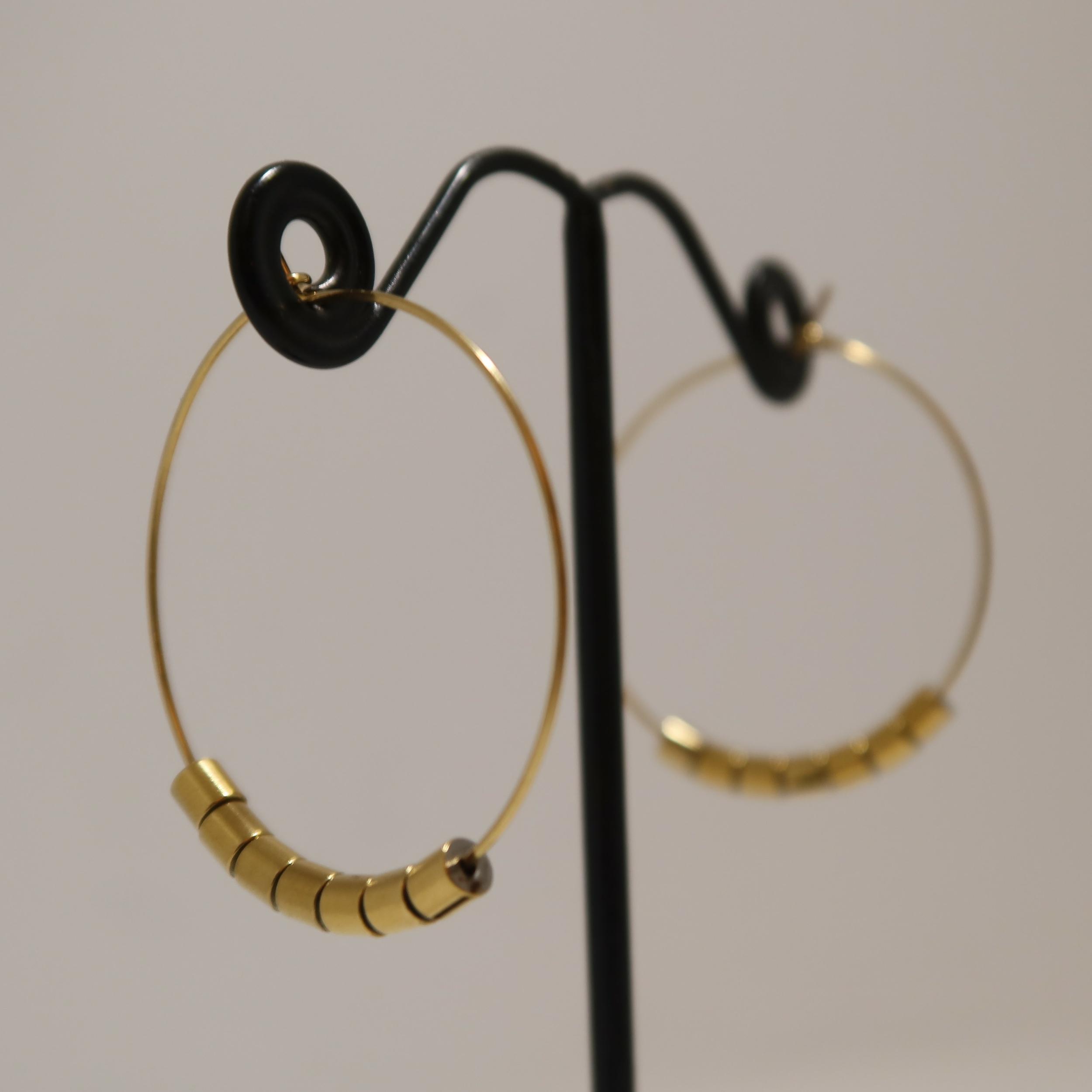 Boucles d\'oreilles dorées - VIA