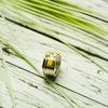 Bague ruban jaune