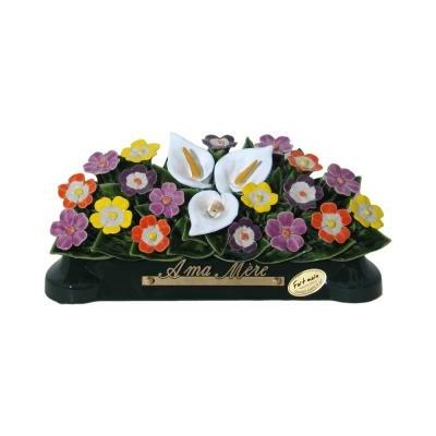 Fleurs céramique devant de tombe arums et primeveres