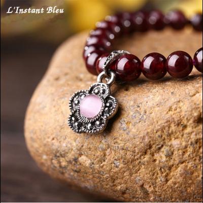 Bracelet bohème «Fleur du Tibet» en Grenat