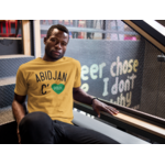 mockup-of-a-black-guy-wearing-a-round-neck-tee-template-while-sitting-on-stairs-a17164