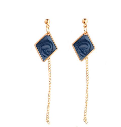 Boucles d\'oreilles bleues (a)symétriques