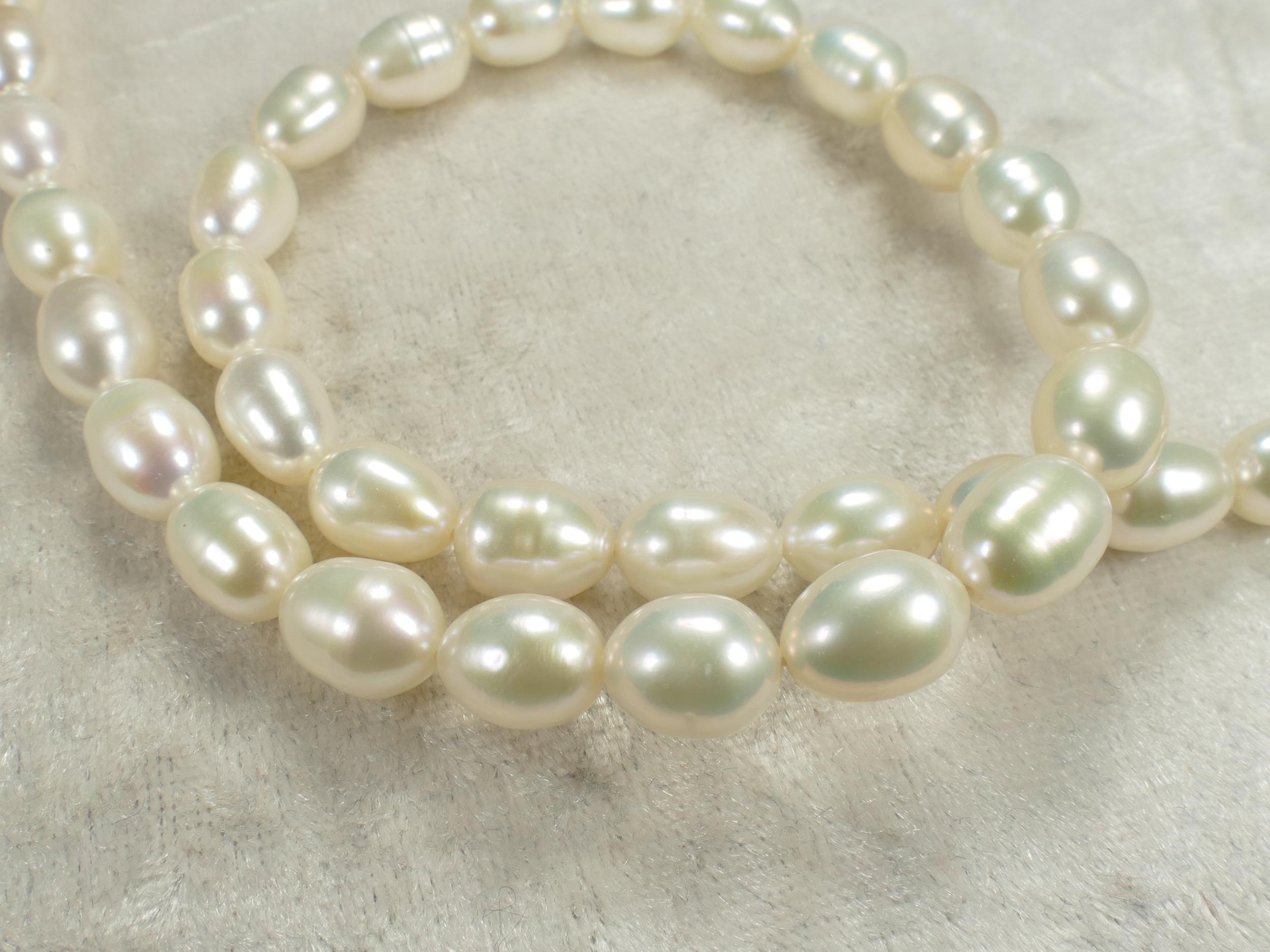 7.3/8.1mm Perle de culture blanche naturelle d\'eau douce ovale (#AC560)