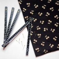 Cherries gold, jersey coton spandex coloris noir 20 x 140 cm