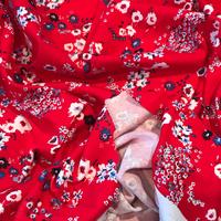 Jersey fleurs fond rouge 20 x 145 cm